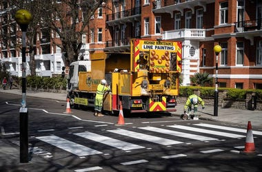 Highway Maintenance team re-paint the iconic Abbey Road crossing on March 24, 2020 in London, England.