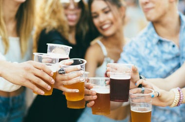 Friends drinking beer and having fun at festival