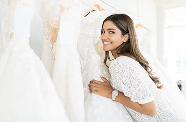Woman selecting bridal gown