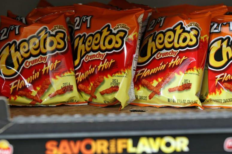 Bags of Flamin' Hot Cheetos`