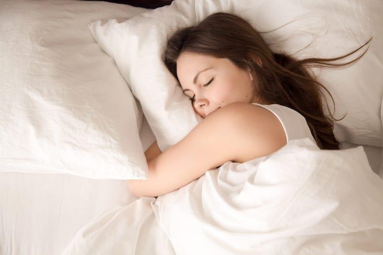 Woman Sleeping, Hugging Pillow