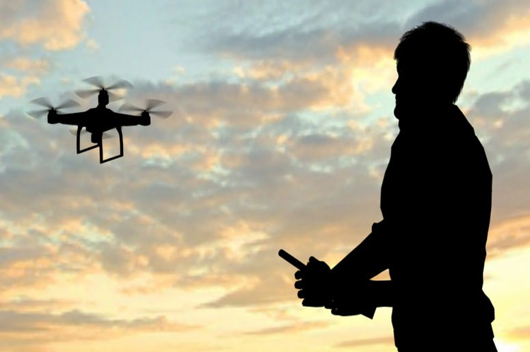 Man operating of flying drone
