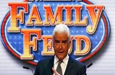 Actor John O'Hurley leads Maya DiRado and Allison Schmitt in a game of Family Feud