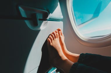 Airplane passenger's propped bare feet