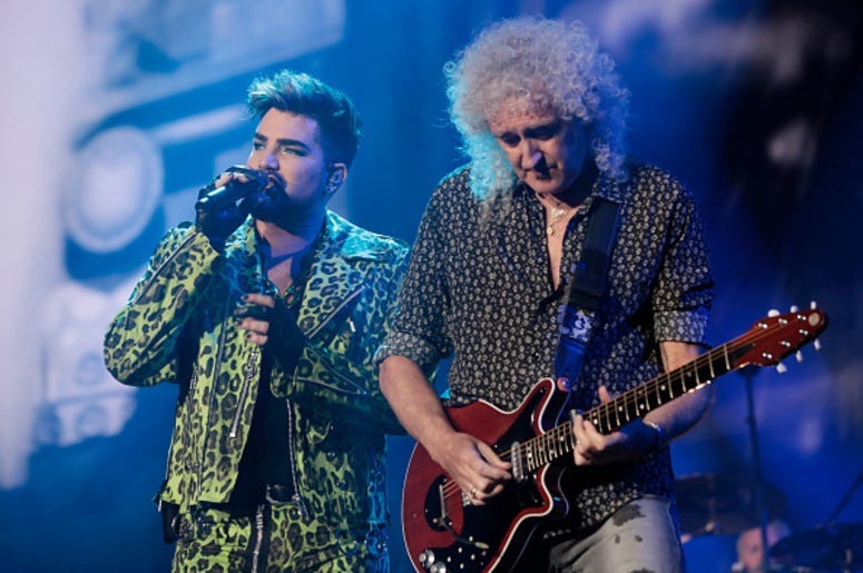 Adam Lambert (L) performs with Brian May of Queen during Fire Fight Australia at ANZ Stadium on February 16, 2020 in Sydney, Australia.