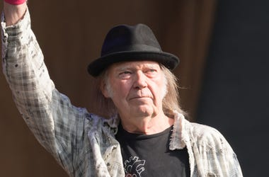Neil Young performing live on stage