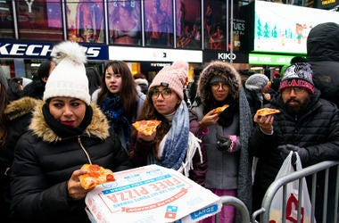 People eating Pizza in Times Square