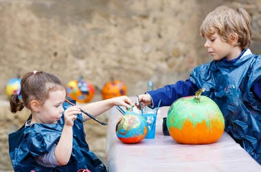 Kids Decorating Pumpkins