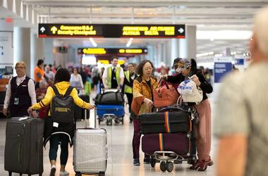 Passengers prepare to check in at Miami International Airport
