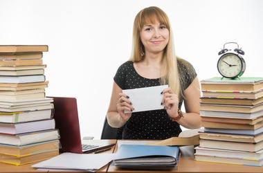 Teacher with a Check