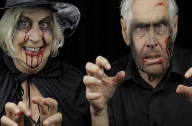 Elderly man and woman in Halloween costumes