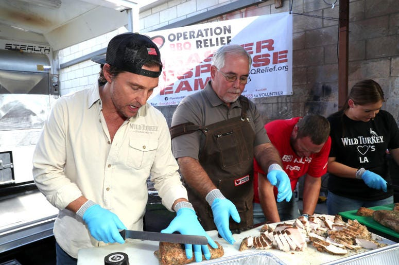 Matthew McConaughey cutting up meat