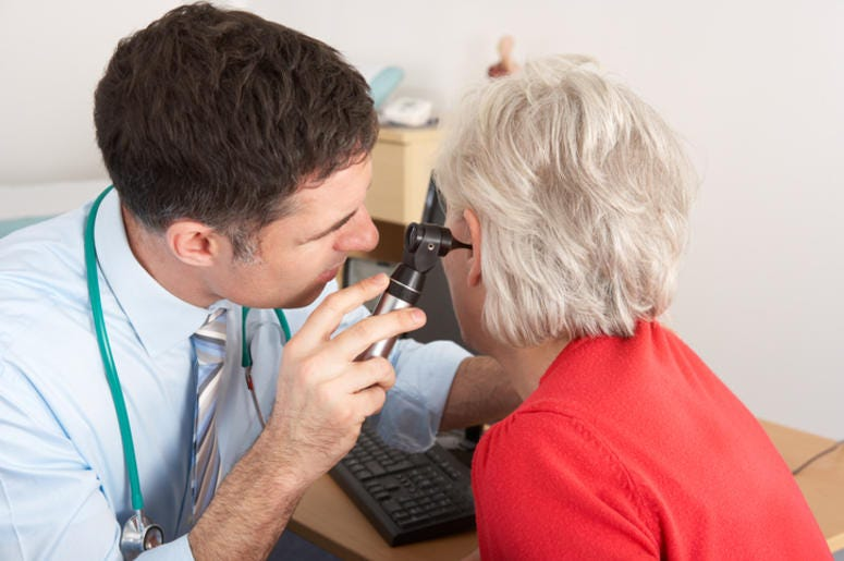 Doctor Looking At A Patients Ear