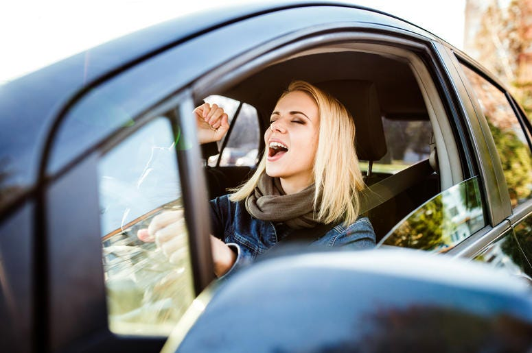 Girl Listening To Music in Her Car
