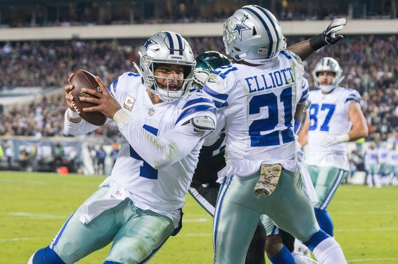 Cowboys quarterback Dak Prescott (4) carries the ball just shy of the goal line against the Eagles, alongside Zeke Elliot (21)