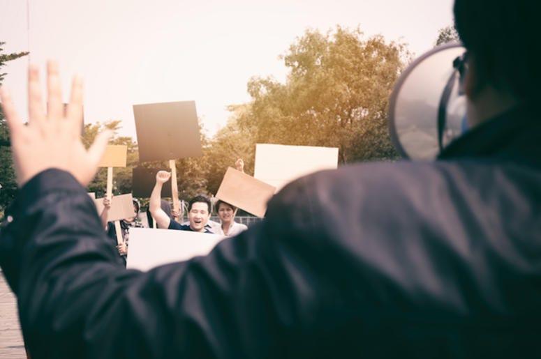 Protestors, Picket Signs, Police, Megaphone