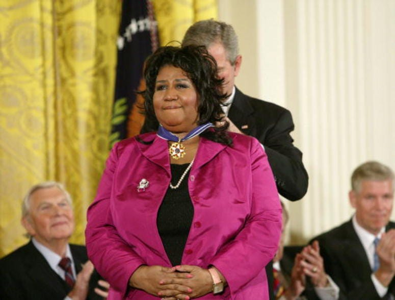 Aretha L. Franklin and President George W. Bush at the Freedom Awards Ceremony at the White House in Washington D.C. on November 9, 2005.