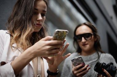 Girls texting on phone