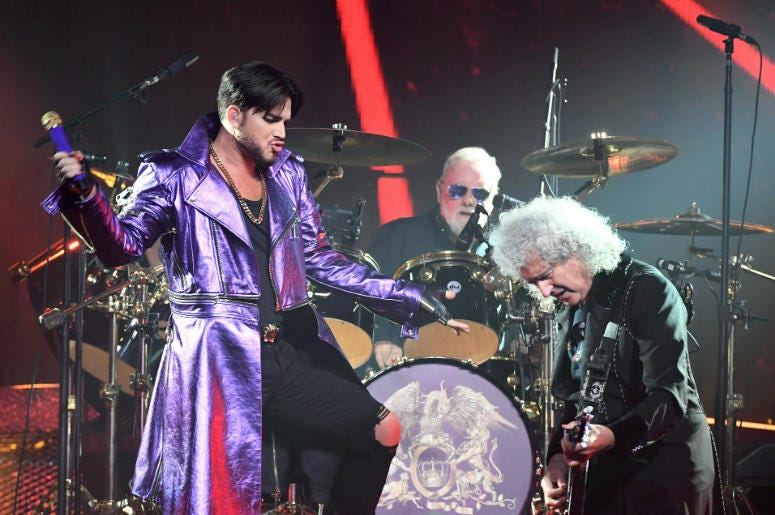 (L-R) Singer Adam Lambert, drummer Roger Taylor and guitarist Brian May of Queen