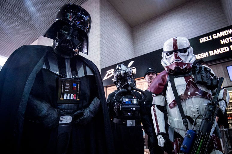 5/26/2017 - EDITORIAL USE ONLY People dressed as Darth Vader and Stormtroopers during the MCM London Comic Con at ExCel London. (Photo by PA Images/Sipa USA) *** US Rights Onl
