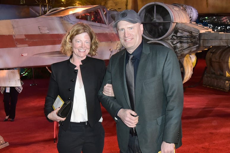 """HOLLYWOOD, CA - DECEMBER 10: President of Marvel Studios Kevin Feige (R) and Caitlin Feige attend The World Premiere of Lucasfilm's highly anticipated, first-ever, standalone Star Wars adventure, """"Rogue One: A Star Wars Story"""" at the Pantages Theatre on D"""