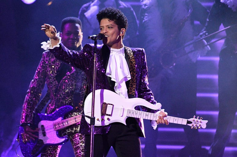 Feb 12, 2017; Los Angeles, CA, USA; Bruno Mars performs during a Prince tribute during the 59th Annual Grammy Awards at Staples Center. Mandatory Credit: Robert Hanashiro-USA TODAY NETWORK