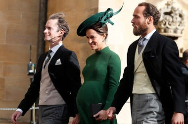 Pippa Middleton, center, arrives with her husband James Matthews, left, and her brother James Middleton for the wedding of Princess Eugenie of York and Jack Brooksbank