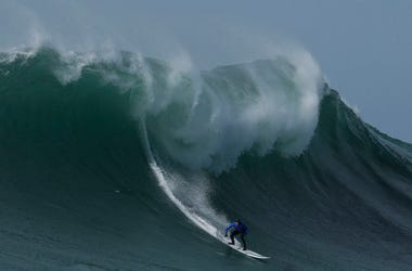 Travis Payne rides a giant wave during the finals of the Mavericks surfing contest in Half Moon Bay