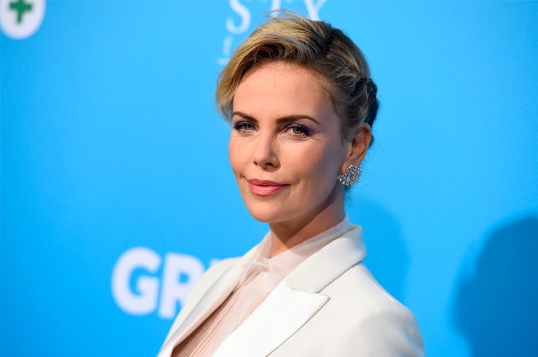 """In this March 6, 2018 file photo, Charlize Theron arrives at the Los Angeles premiere of """"Gringo"""" at Regal L.A. Live. Theron was quoted in an Elle magazine interview published last week saying that she wouldn't travel to parts of the United States with he"""
