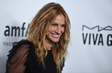 "In this Oct. 13, 2017, file photo, Julia Roberts attends the 2017 amfAR Inspiration Gala Los Angeles in Beverly Hills, Calif. The ""Pretty Woman"" star has joined Instagram, posting a photo of herself sitting on the grass in denim shorts and a black top tha"
