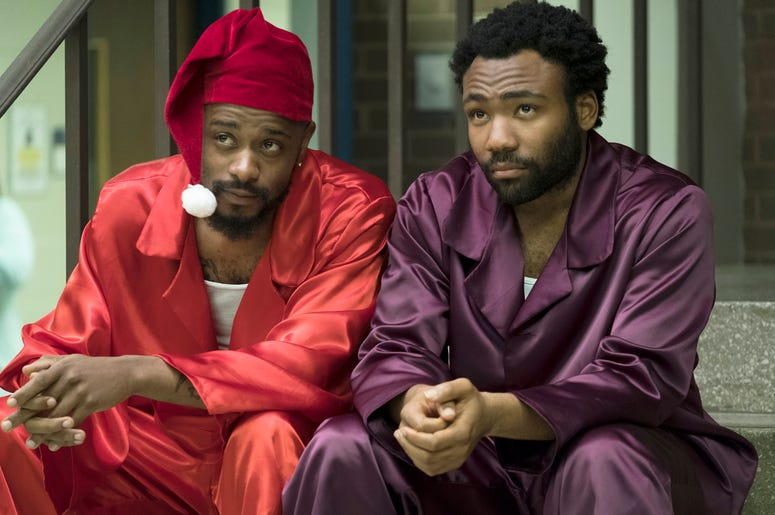 """This image released by FX shows Lakeith Stanfield, left, and Donald Glover in a scene from the comedy series """"Atlanta."""" Glover was nominated Thursday for an Emmy for outstanding lead actor in a comedy series. The 70th Emmy Awards will be held on Monday, S"""