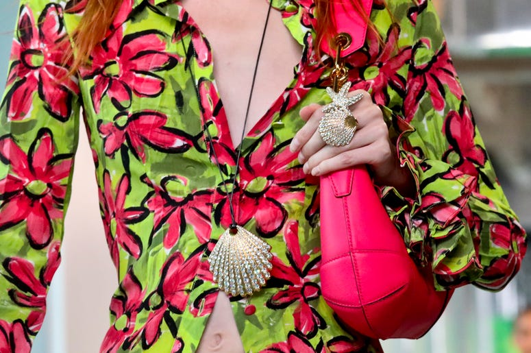 Fashion from the Michael Kors collection is modeled during Fashion Week, Wednesday Sept. 12, 2018 in New York. (AP Photo/Bebeto Matthews