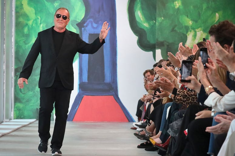 Fashion designer Michael Kors acknowledges applause after unveiling his latest collection during Fashion Week, Wednesday, Sept. 12, 2018, in New York. (AP Photo/Bebeto Matthews)