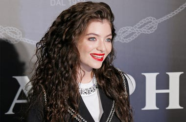 In this Nov. 18, 2014, file photo, singer Lorde poses for photographers during an promotional event in Hong Kong. An Israeli court has ordered two New Zealand women to pay over $12,000 in damages for allegedly helping persuade the pop singer Lorde to canc