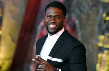 "In this Dec. 11, 2017 file photo, Kevin Hart arrives at the Los Angeles premiere of ""Jumanji: Welcome to the Jungle"" in Los Angeles. Hart will host the 2019 Academy Awards, fulfilling a lifelong dream for the actor-comedian. Hart announced Tuesday, Dec. 4"