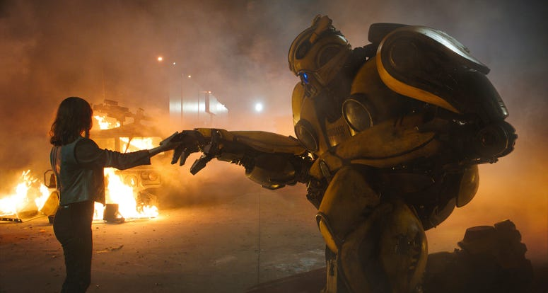 """This image released by Paramount Pictures shows Hailee Steinfeld as Charlie and Bumblebee in a scene from """"Bumblebee."""" (Paramount Pictures via AP)"""