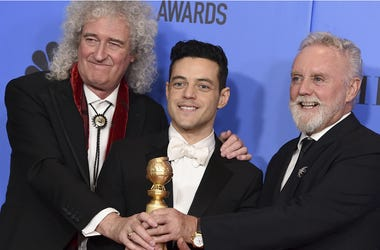"Brian May, left, and Roger Taylor, right, of Queen, and Rami Malek pose in the press room with the award for best motion picture, drama for ""Bohemian Rhapsody"" at the 76th annual Golden Globe Awards at the Beverly Hilton Hotel on Sunday, Jan. 6, 2019, in"