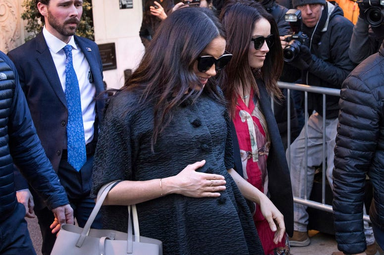 Meghan, Duchess of Sussex, leaves the Surrey Hotel ahead of her baby shower at the Mark Hotel on Tuesday, Feb. 19, 2019, in New York. (AP Photo/Kevin Hagen)
