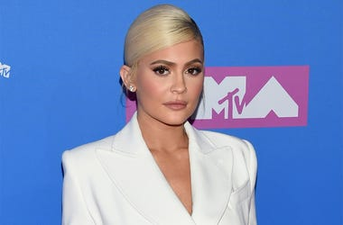 In this Monday, Aug. 20, 2018 file photo, Kylie Jenner arrives at the MTV Video Music Awards at Radio City Music Hall in New York. At 21, Jenner has been named the youngest-ever, self-made billionaire by Forbes magazine in March 2019. (Photo by Evan Agost
