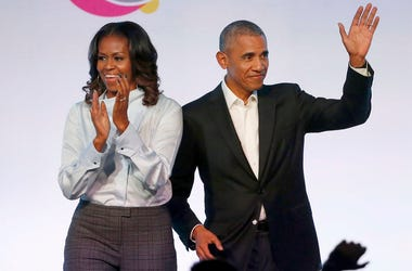 In this Oct. 31, 2017, file photo, former President Barack Obama, right, and former first lady Michelle Obama appear at the Obama Foundation Summit in Chicago. (Photo credit: AP Photo/Charles Rex Arbogast, File)