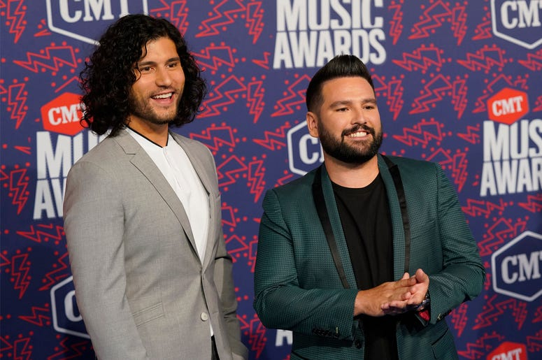 Dan Smyers, left, and Shay Mooney, of Dan + Shay, arrive at the CMT Music Awards on Wednesday, June 5, 2019, at the Bridgestone Arena in Nashville, Tenn. (AP Photo/Sanford Myers)