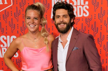 This June 5, 2019 file photo shows Lauren Akins, left, and Thomas Rhett at the CMT Music Awards in Nashville, Tenn. Rhett announced on social media that his wife is pregnant with another girl. (AP Photo/Sanford Myers, File)