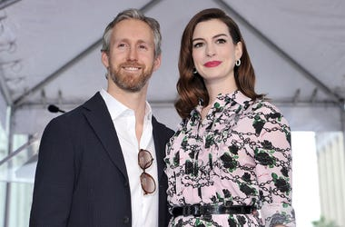This May 9, 2019 file photo shows actress Anne Hathaway, right, and her husband Adam Shulman at a ceremony honoring Hathaway with a star on the Hollywood Walk of Fame in Los Angeles.  (Photo by Richard Shotwell/Invision/AP, File)