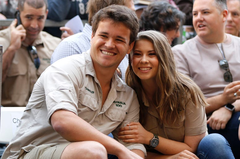 This April 26, 2018 file photo shows Chandler Powell, left, and Bindi Irwin at a ceremony honoring the late Steve Irwin with a star on the Hollywood Walk of Fame in Los Angeles. (Photo by Willy Sanjuan/Invision/AP, File)