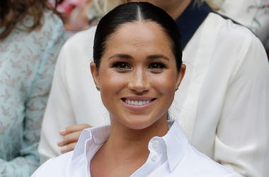 In this July 13, 2019 file photo, Kate, Meghan, Duchess of Sussex smiles while sitting in the Royal Box on Centre Court to watch the women's singles final match between Serena Williams, of the United States, and Romania's Simona Halep on at the Wimbledon