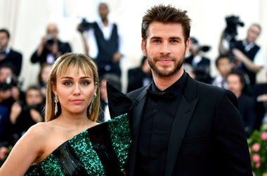 "In this May 6, 2019 file photo, Miley Cyrus, left, and Liam Hemsworth attend The Metropolitan Museum of Art's Costume Institute benefit gala celebrating the opening of the ""Camp: Notes on Fashion"" exhibition in New York. (Photo by Charles Sykes/Invision/A"