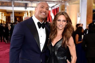 In this Feb. 22, 2015, file photo Dwayne Johnson, left, and Lauren Hashian arrive at the Oscars at the Dolby Theatre in Los Angeles.