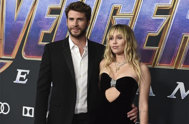 "In this Monday, April 22, 2019, file photo, Liam Hemsworth, left, and Miley Cyrus arrive at the premiere of ""Avengers: Endgame"" at the Los Angeles Convention Center. (Photo by Jordan Strauss/Invision/AP, File)"