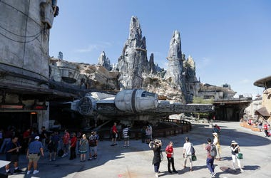 In this Tuesday, Aug. 27, 2019, file photo, park visitors walk near the entrance to the Millennium Falcon Smugglers Run ride during a preview of the Star Wars themed land, Galaxy's Edge in Hollywood Studios at Disney World in Lake Buena Vista, Florida. (A