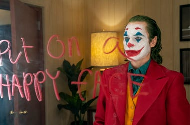 "This image released by Warner Bros. Pictures shows Joaquin Phoenix in a scene from the film, ""Joker."" (Niko Tavernise/Warner Bros. Pictures via AP)"